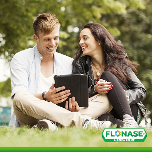 Couple at park researching allergy relief products