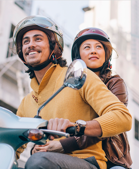 photo of man and woman on scooter