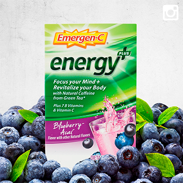 Package of Emergen-C Energy Plus in Blueberry-Acai flavor resting on a pile of fresh blueberries.