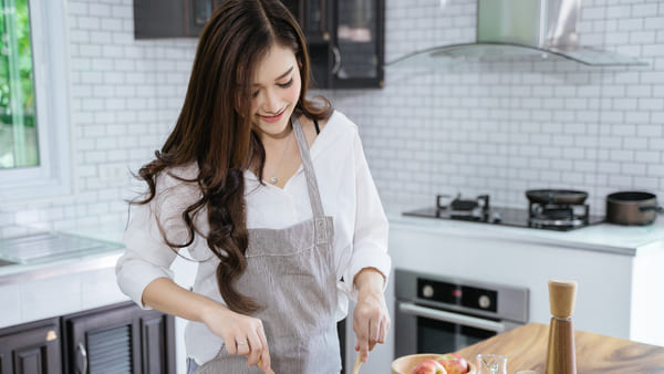 Woman making salad in the kitchen