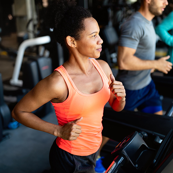 Woman running on a treadmill in an exercise class
