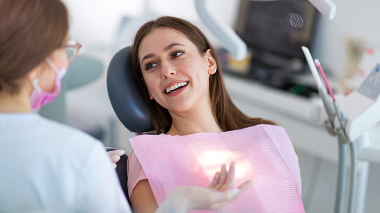 Image of patient in a Dentists chair. Click to access oral health page.