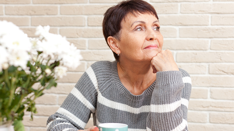 A lady thinking about her joint pain