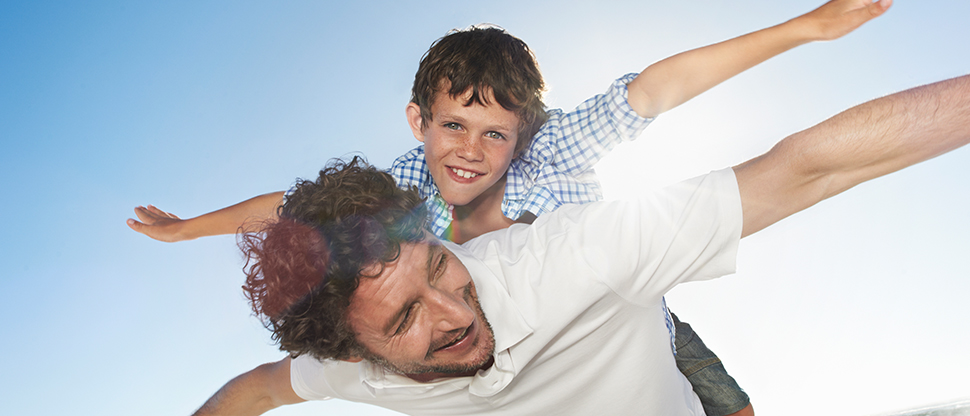 Man with boy on his back