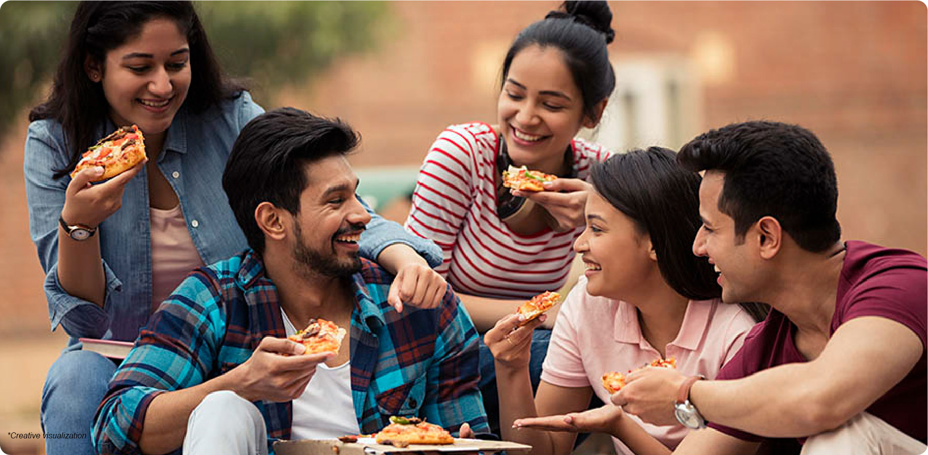 Young group of friendslaughing and eating pizza