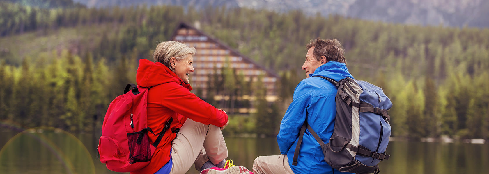 Senior Hikers Couple During The Walk Round The Tarn In Beautiful Mountains Hills