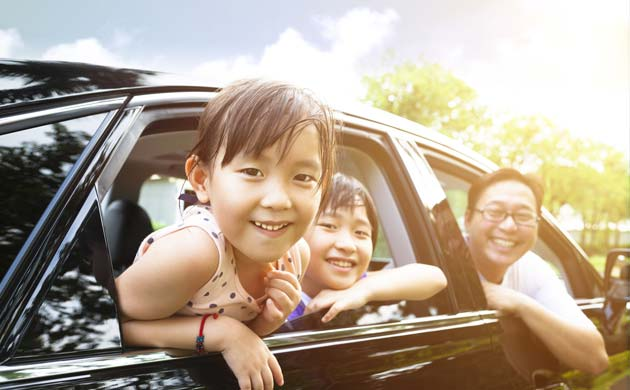 Family looking out of car