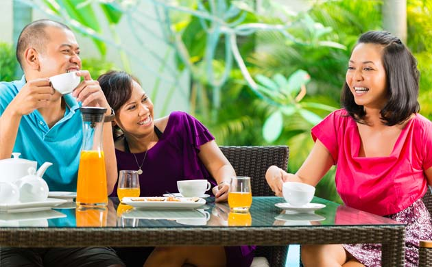 3 friends chatting over breakfast