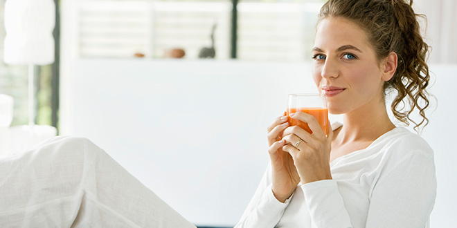 Woman Holding a Cup of Juice Header