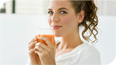 Woman Holding a Cup of Juice